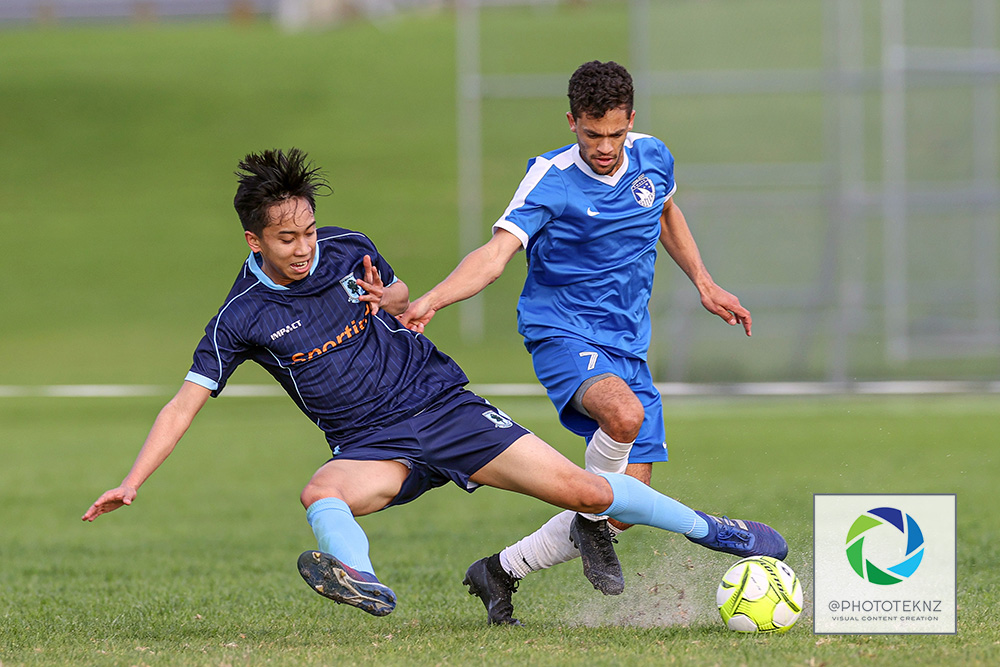 Beachlands Adrian Crowe is tackled by Northland's Roashan Calustre. NRFL, Northern Region Football League Division Two, Beachlands Maraetai v Northland FC, Te Puru Park Auckland, Saturday 20th June 2020. Photo: Shane Wenzlick / www.phototek.nz