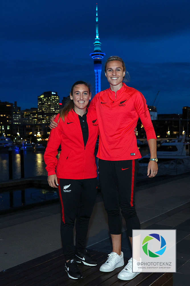 Ferns Annalie Longo and Hannah Wilkinson pose for pictures ahead af the FIFA Women's World Cup 2023 hosting announcement. The Auckland Sky Tower lit in blue and green colours in support of the Australia / New Zealand Women's World Cup Bid, Viaduct Auckland, Thursday 25th June 2020.  Photo: Shane Wenzlick / www.phototek.nz
