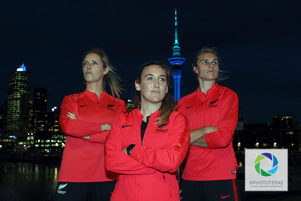 Ferns Annalie Longo, Erin Nayler and Hannah Wilkinson pose for pictures ahead af the FIFA Women's World Cup 2023 hosting announcement. The Auckland Sky Tower lit in blue and green colours in support of the Australia / New Zealand Women's World Cup Bid, Viaduct Auckland, Thursday 25th June 2020.  Photo: Shane Wenzlick / www.phototek.nz
