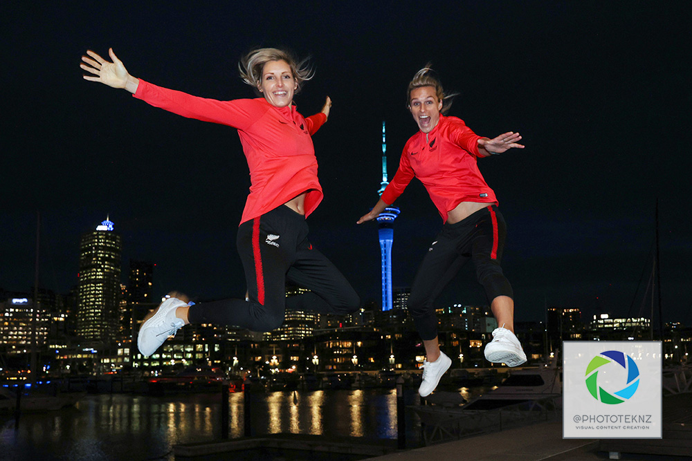 Ferns Erin Nayler and Hannah Wilkinson  pose for pictures ahead af the FIFA Women's World Cup 2023 hosting announcement. The Auckland Sky Tower lit in blue and green colours in support of the Australia / New Zealand Women's World Cup Bid, Viaduct Auckland, Thursday 25th June 2020.  Photo: Shane Wenzlick / www.phototek.nz