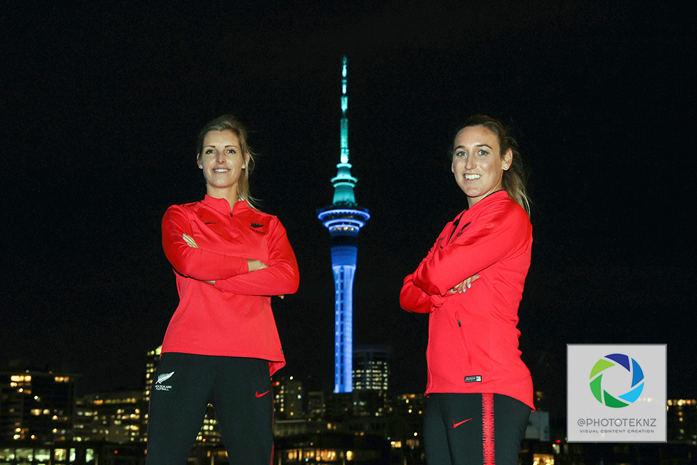 Ferns Erin Nayler and Annalie Longo pose for pictures ahead af the FIFA Women's World Cup 2023 hosting announcement. The Auckland Sky Tower lit in blue and green colours in support of the Australia / New Zealand Women's World Cup Bid, Viaduct Auckland, Thursday 25th June 2020.  Photo: Shane Wenzlick / www.phototek.nz