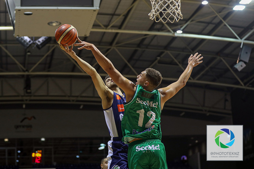 Jets Hyrum Harris blocks Giants Nic Trathen during the NBL match between the Nelson Giants and the Manawatu Jets, National Basketball League held at Trusts Stadium, Auckland, New Zealand. 28 June 2020. Copyright Photo: Shane Wenzlick / www.photosport.nz