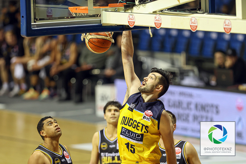 Nuggets Jordan Hunt slam dunks during the NBL match between the Otago Nuggets and the Franklin Bulls, National Basketball League held at Trusts Stadium, Auckland, New Zealand. 2 July 2020. Copyright Photo: Shane Wenzlick / www.photosport.nz