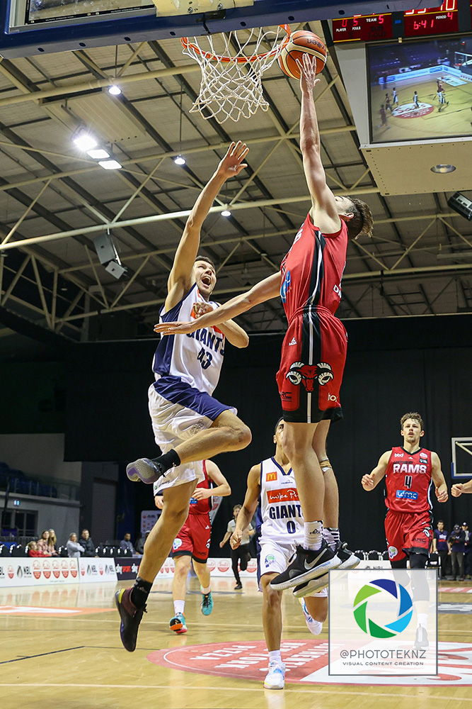 Rams Taylor Britt shoots ahead of Giants Dane Brooks during the NBL match between the Canterbury Rams and the Nelson Giants, National Basketball League held at Trusts Stadium, Auckland, New Zealand. 2 July 2020. Copyright Photo: Shane Wenzlick / www.photosport.nz
