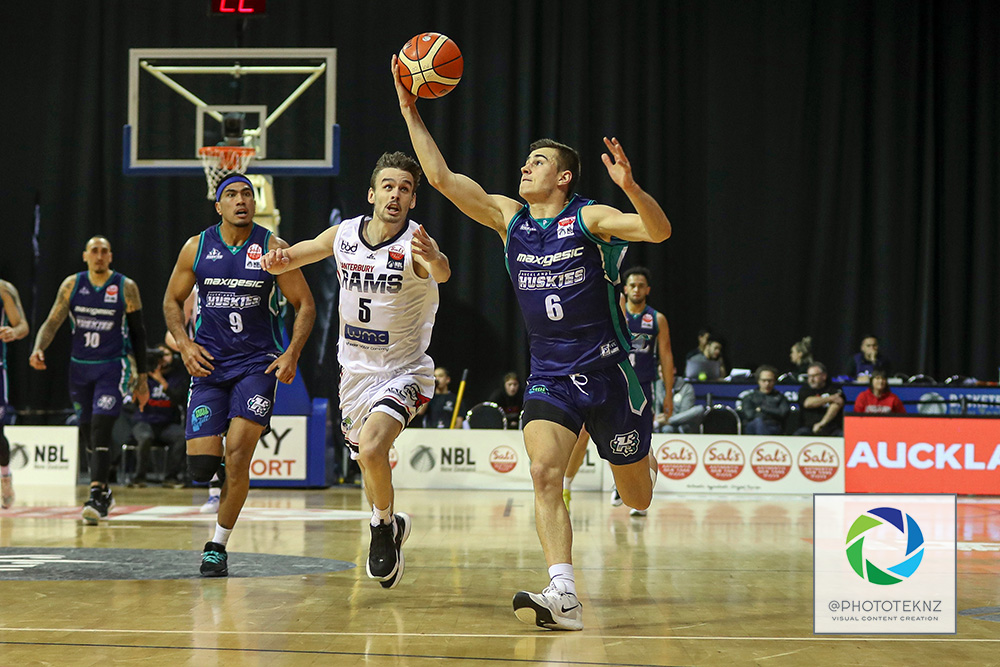 Huskies Taine Murray collects in the loose ball ahead of Rams Taylor Britt during the NBL match between the Auckland Huskies and the Canterbury Rams, National Basketball League held at Trusts Stadium, Auckland, New Zealand. 9 July 2020. Copyright Photo: Shane Wenzlick / www.photosport.nz
