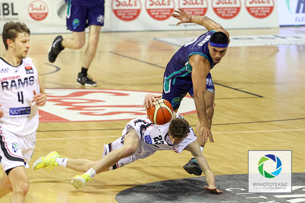 Rams Ben Carlile-Smith is taken out by Huskies Anamata Haku during the NBL match between the Auckland Huskies and the Canterbury Rams, National Basketball League held at Trusts Stadium, Auckland, New Zealand. 9 July 2020. Copyright Photo: Shane Wenzlick / www.photosport.nz